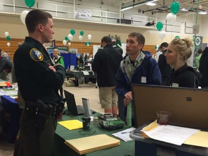 Officer Kevin Bronson discussing the job with PSC students Shawn Boland and Cat Leist.