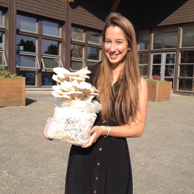 Kristina Castine with mushroom kits