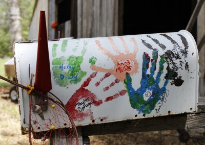 The students added a personal touch to Osgood Farm, by painting an old mailbox and leaving their mark.