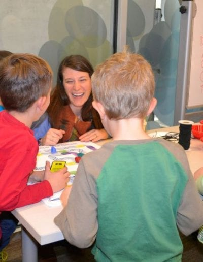 """Dr. Eidem making science fun with the """"Transcribe your Genes"""" boardgame at the Boulder Public Library."""